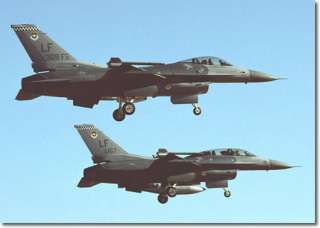 and f 16d below prepare for landing 308th fighter squadron luke afb az