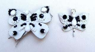 LOT OF TWO BLACK AND WHITE BUTTERFLY HAIR ORNAMENTS OR BARRETTES