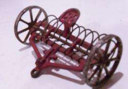 Vintage Arcade cast iron hay rake farm toy tractor equipment