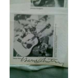 2x3 Autograph on small piece of news paper with picture of