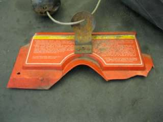 This is a used headlight/gauge dash pod from an 1990s Polaris.